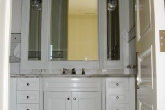 Guest room cabinetry in white.
