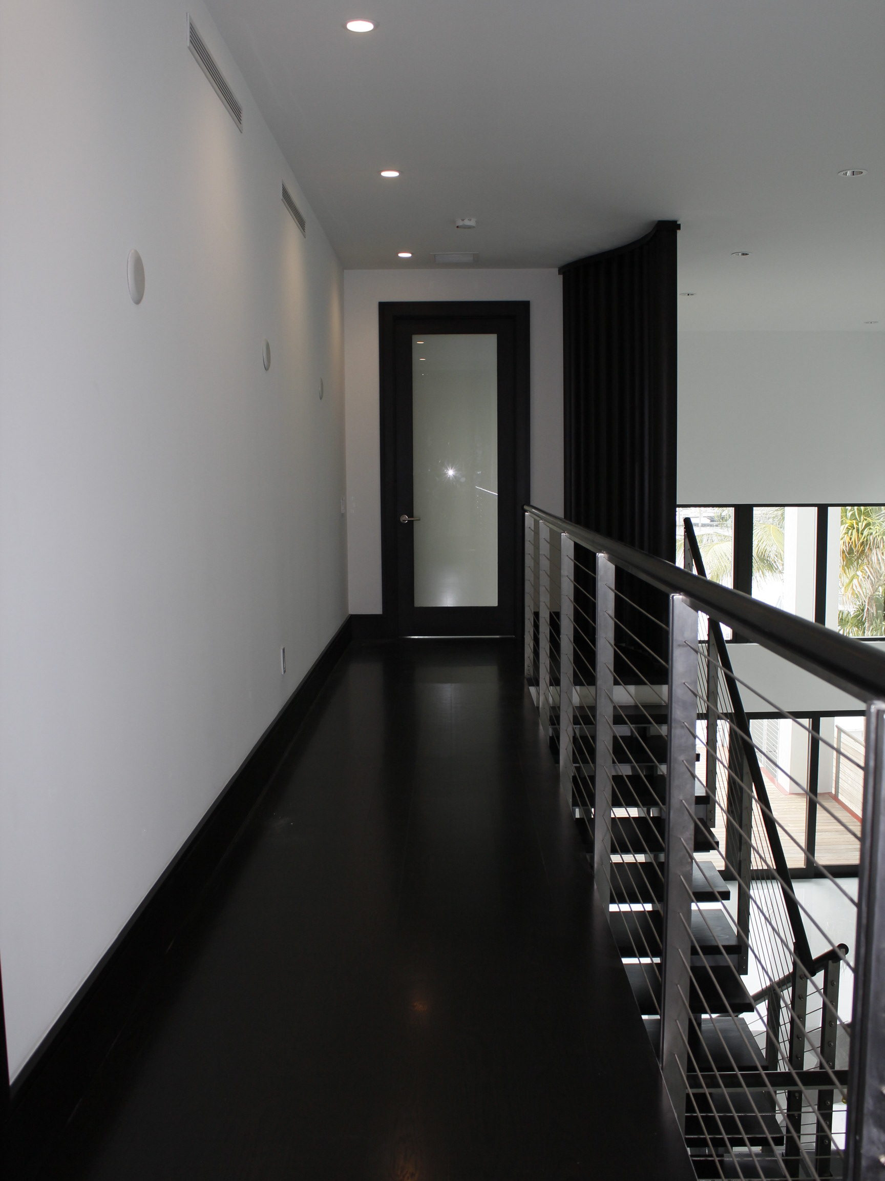 The open railing design allows the feel of a floating second floor.