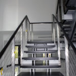 Floating staircase & railing designed by Portuondo-Perotti Architects.