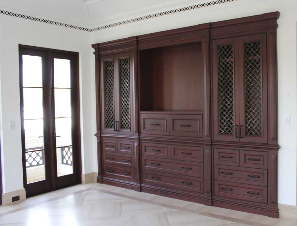 Architectural Resources sourced, milled, finished and installed this mahogany unit for the master sitting room.