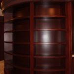 Architectural Resources, guided by the  drawings of Phillip Chapelle fabricated, finished and installed this old world mahogany unit that graces an area of the master closet.