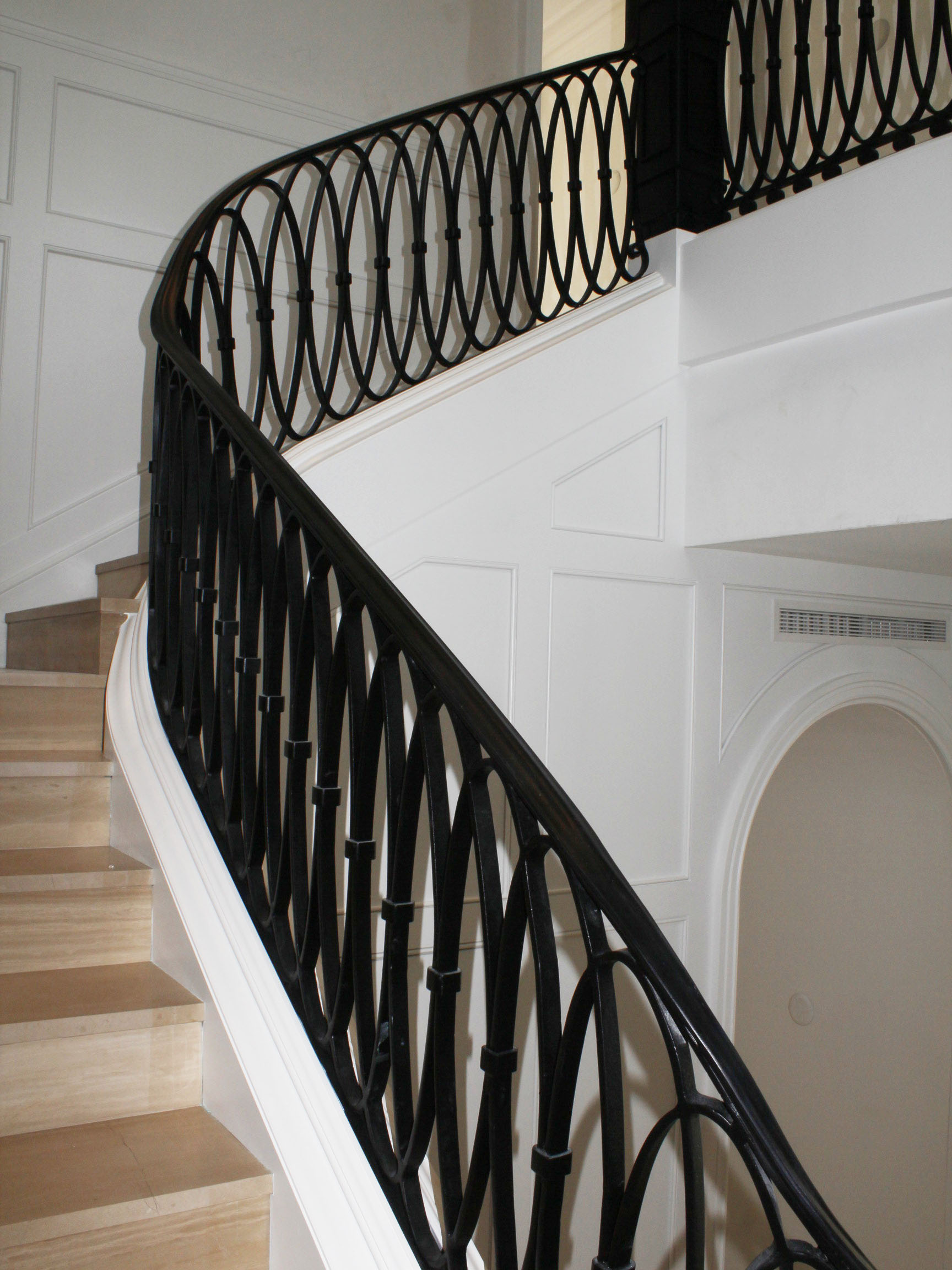 Another view of the spiral staircase curved millwork.
